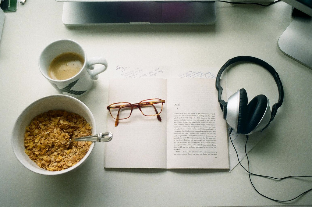 Picture of a real desktop with breakfast items, glasses, etc.